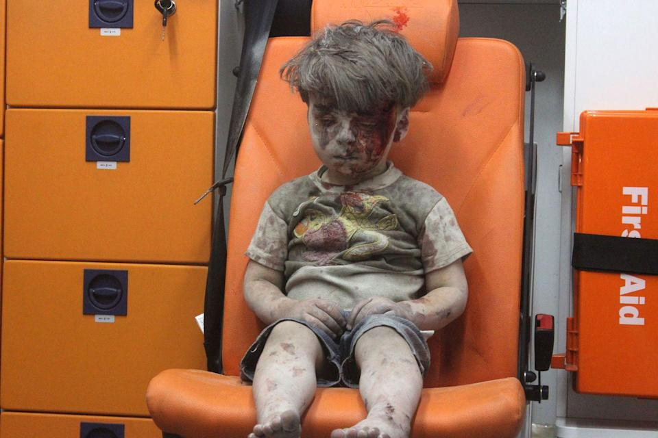 <p>Omran Daqneesh, 5, of Syria sits alone in the back of the ambulance after he was injured during an air strike targeting the Qaterji neighborhood of Aleppo.</p>