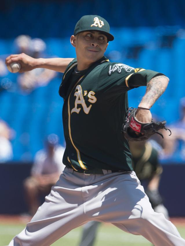 Oakland Athletics starting pitcher Jesse Chavez works against the Toronto Blue Jays during the first inning of a baseball game in Toronto on Saturday, May 24, 2014. (AP Photo/The Canadian Press, Darren Calabrese)