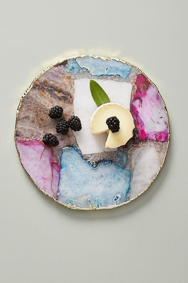 """Hey, you're going to need something to wash down those drinks and this cheeseboard can be used for <br>charcuterie plate and hors d'oeuvres, too. <a href=""""https://fave.co/2R1l3Un"""" rel=""""nofollow noopener"""" target=""""_blank"""" data-ylk=""""slk:Find it for $78 at Anthropologie"""" class=""""link rapid-noclick-resp"""">Find it for $78 at Anthropologie</a>."""