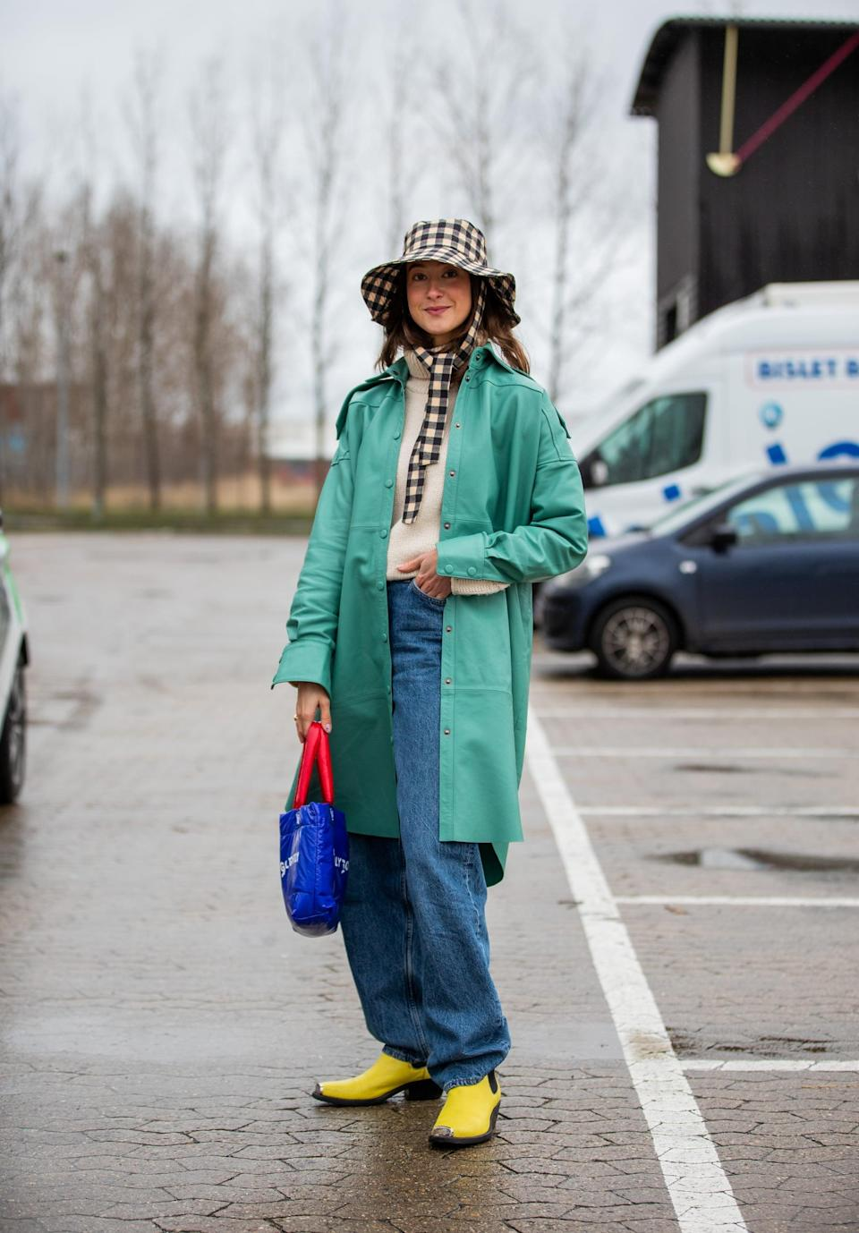 <p>If you're here for a quirky look, don't sleep on this colorful baggy-jean outfit. The bucket hat and bright boots are key.</p>