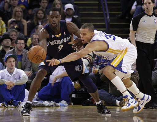Golden State Warriors' Stephen Curry, right, attempts to steal the ball from Memphis Grizzlies' Tony Allen (9) during the first half of an NBA basketball game Wednesday, March 7, 2012, in Oakland, Calif. (AP Photo/Ben Margot)