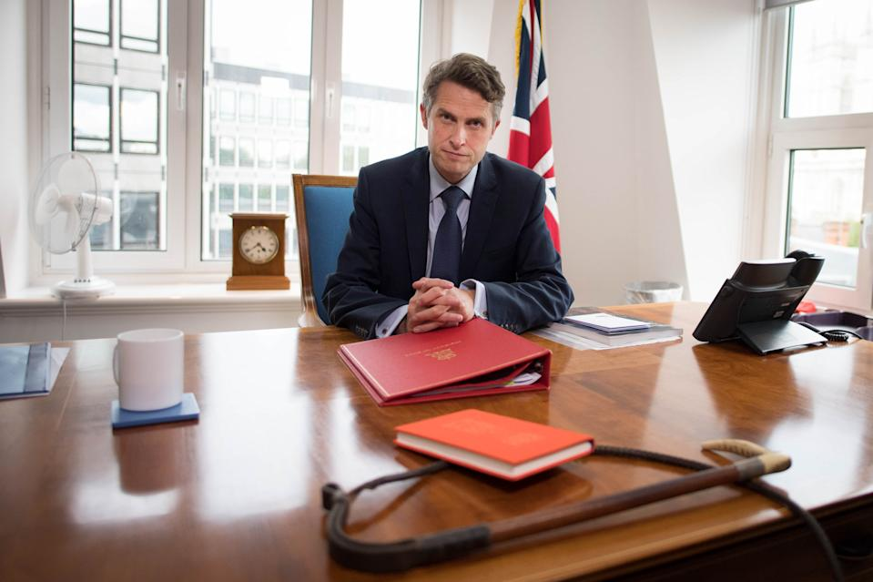 Gavin Williamson sat at his desk, in front of a whip, on 17 August. (Stefan Rousseau/PA)