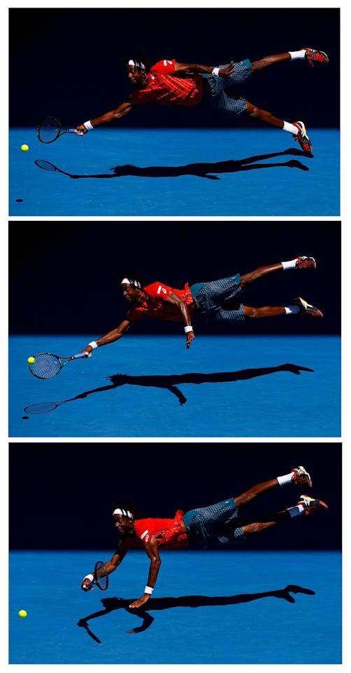 A combination photo shows France's Monfils diving for a shot during his fourth round match against Russia's Kuznetsov at the Australian Open tennis tournament at Melbourne Park