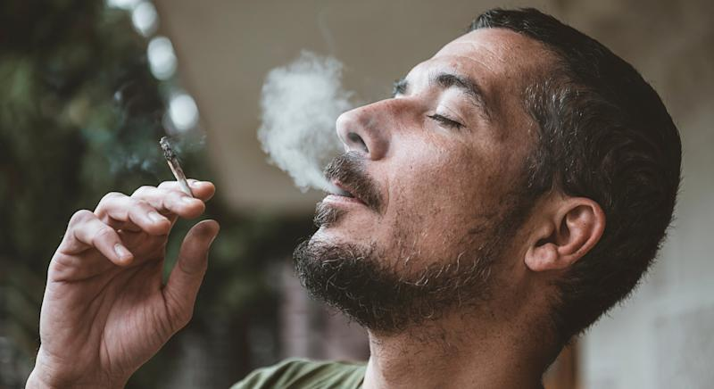 Men who regularly smoke cannabis are at greater risk of testicular cancer [Image: Getty]