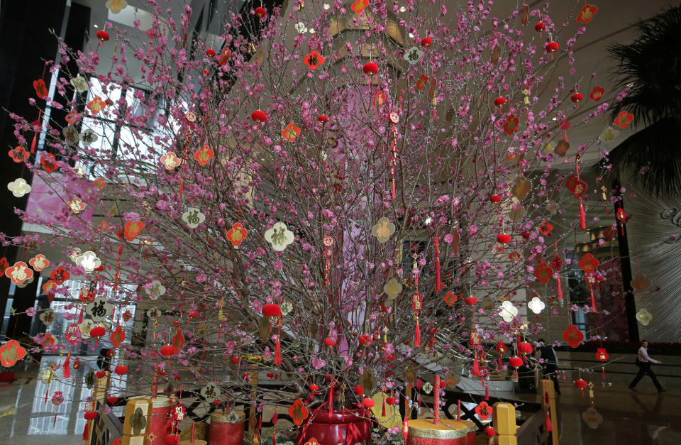 A huge peach blossom is displayed as Chinese New Year decorations at an office building in Hong Kong, Thursday, Jan. 31, 2019. Chinese will celebrate the lunar new year on Feb. 5 this year which marks the Year of the Pig in the Chinese zodiac. (AP Photo/Vincent Yu)