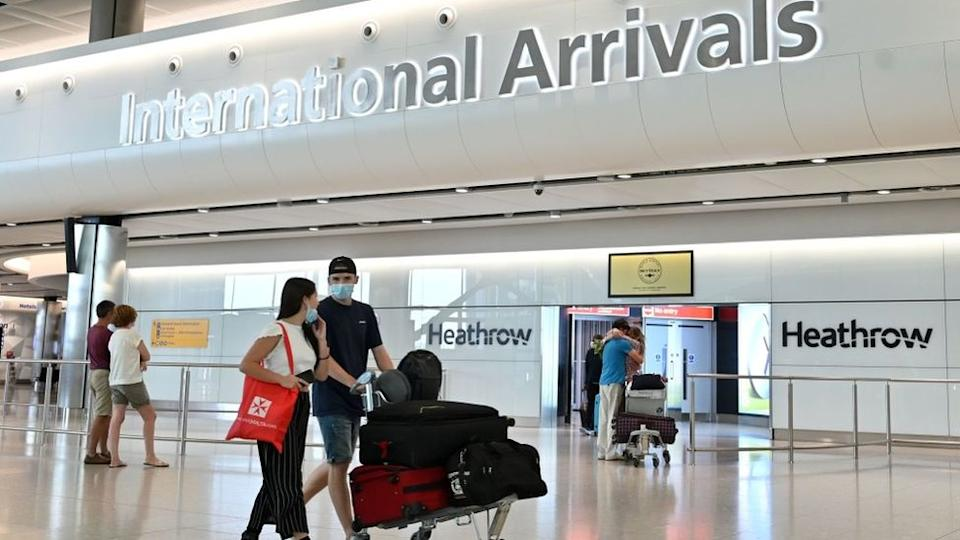 Passengers arrive at London Heathrow airport