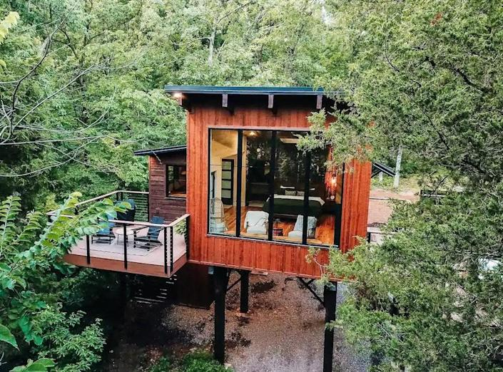 """<p><strong>Perryville, Missouri</strong></p> <p>For a design-focused tree house experience, consider TreeLoft at BaseCamp. A skylight just above the king-size bed allows for night-sky gazing with a remote solar shade to keep you sleeping in the wee morning hours. There's a rain shower for two in the walk-through bathroom, a relaxing soaking tub, and plush robes for your comfort. The kitchen offers an indoor-outdoor coffee bar and tiny appliances for all your cooking needs. Outside you'll find a hot tub placed next to towering eastern red cedar trees with a privacy fence, a separate deck for grilling or nesting in the trees, and a fire pit below with ambient lighting for s'mores or storytelling to make this a one-of-a-kind experience.</p> $254, Airbnb. <a href=""""https://www.airbnb.com/rooms/44119404"""" rel=""""nofollow noopener"""" target=""""_blank"""" data-ylk=""""slk:Get it now!"""" class=""""link rapid-noclick-resp"""">Get it now!</a>"""