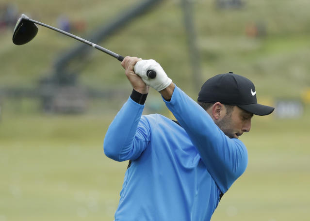 Italy's Francesco Molinari prepares to take a shot on the practice range ahead of the start of the British Open golf championships at Royal Portrush in Northern Ireland, Wednesday, July 17, 2019. The British Open starts Thursday. (AP Photo/Matt Dunham)