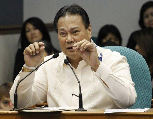 Supreme Court Chief Justice Renato Corona attends his impeachment trial at the Senate in Manila on May 25