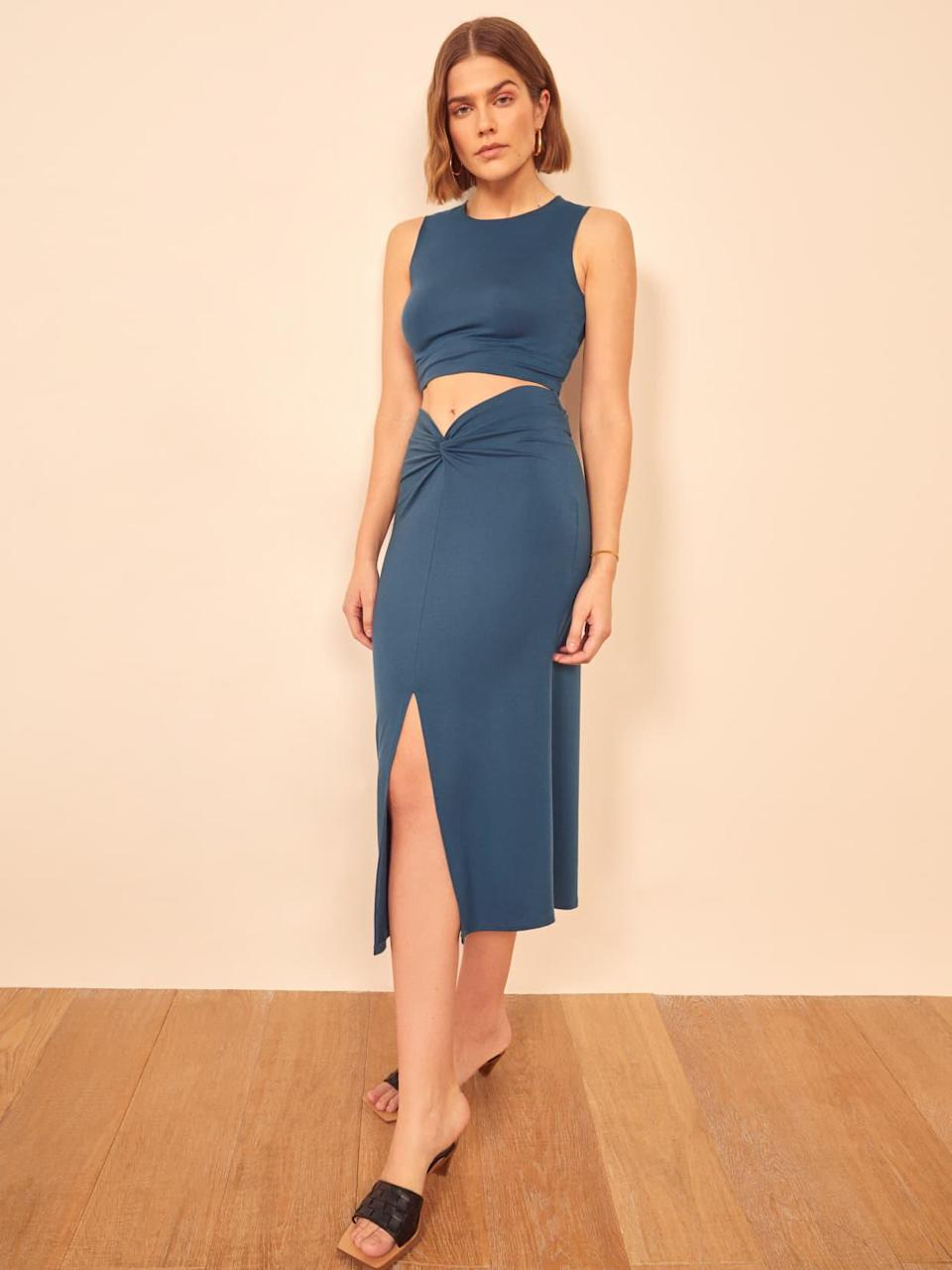 "<br> <br> <strong>Reformation</strong> Rylan Two Piece, $, available at <a href=""https://go.skimresources.com/?id=30283X879131&url=https%3A%2F%2Fwww.thereformation.com%2Fproducts%2Frylan-two-piece%3Fcolor%3DOcean"" rel=""nofollow noopener"" target=""_blank"" data-ylk=""slk:Reformation"" class=""link rapid-noclick-resp"">Reformation</a>"