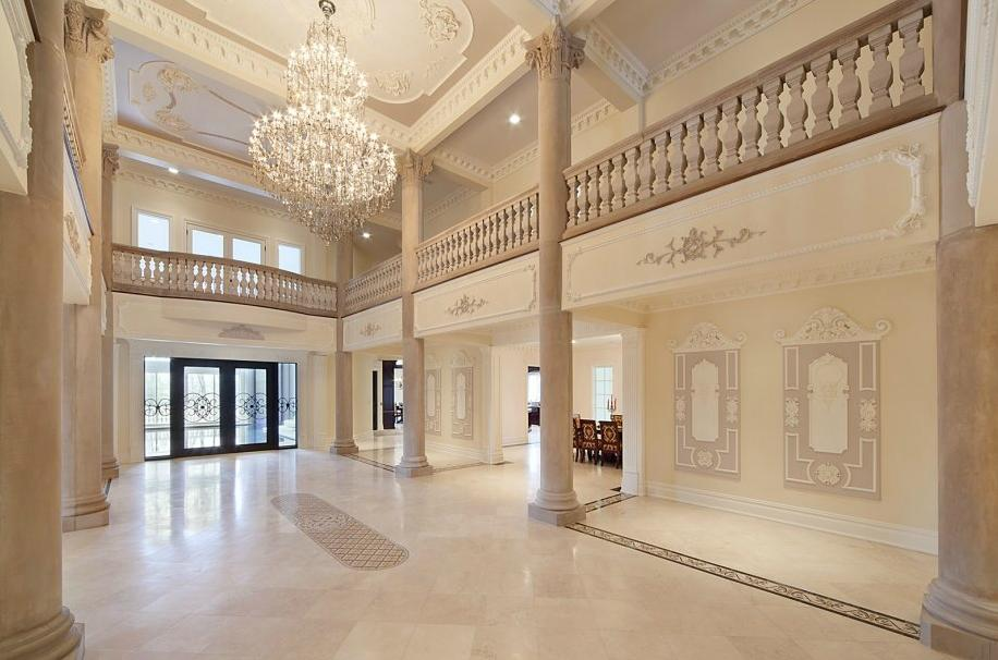 An American 'palace' with a pool at its heart grand entry hall