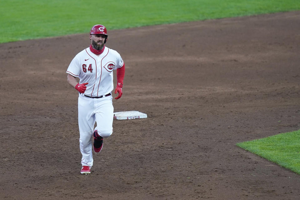Cincinnati Reds first baseman Matt Davidson (64) runs the bases after hitting a two run home run during the third inning of a baseball game against the Kansas City Royals at Great American Ballpark in Cincinnati, Tuesday, Aug. 11, 2020. (AP Photo/Bryan Woolston)