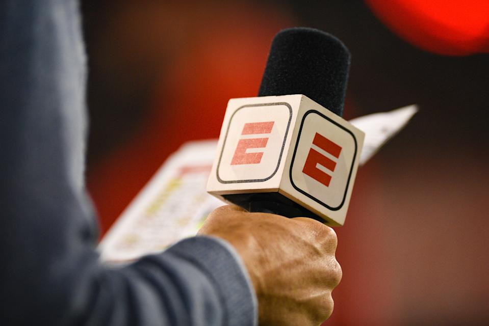 CINCINNATI, OH - OCTOBER 04: ESPN sideline reporter Paul Carcaterra holding a mic during a college football game between the University of Central Florida Knights (UCF) and Cincinnati Bearcats on October 4, 2019 at Nippert Stadium in Cincinnati, OH  (Photo by James Black/Icon Sportswire via Getty Images)