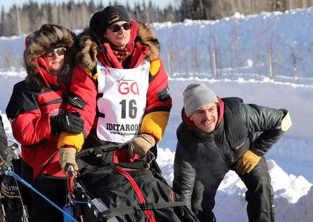 FILE PHOTO: Two-times champion Mitch Seavey waits with his wife at the official restart gate of the Iditarod, a nearly 1,000 mile (1,610 km) sled dog race across the Alaskan wilderness, in Fairbanks, Alaska, U.S. March 6, 2017.  REUTERS/Nathaniel Wilder/File Photo