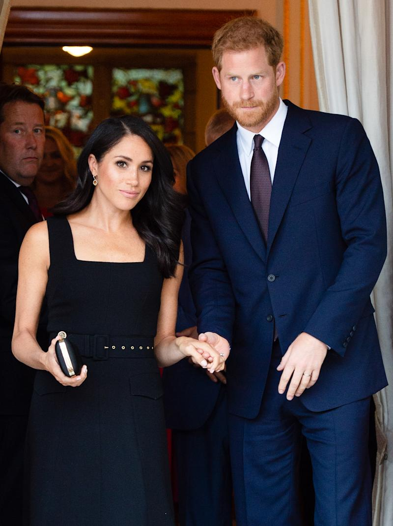 Prince Harry and Meghan walk hand in hand at event