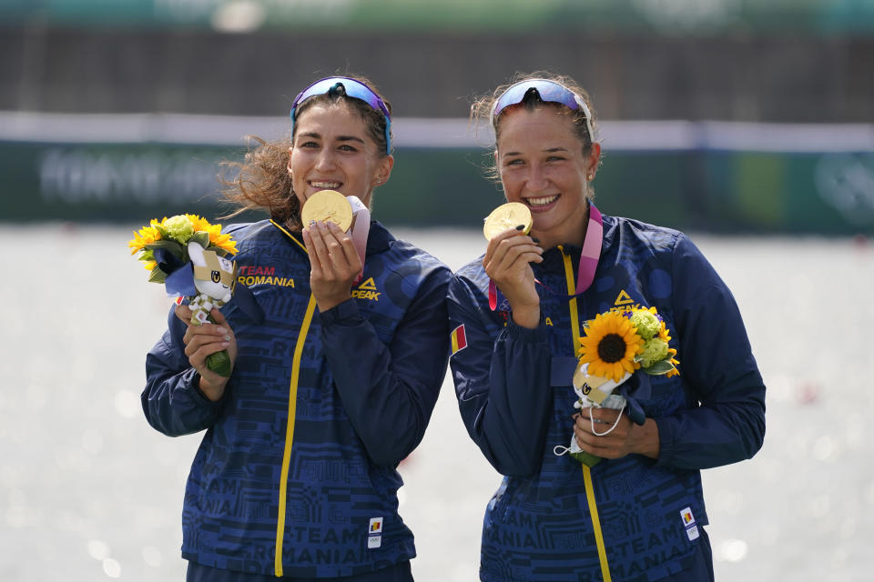 Gold medalist Ancuta Bodnar and Simona Radis of Romania pose after winning the women's rowing double sculls final at the 2020 Summer Olympics, Wednesday, July 28, 2021, in Tokyo, Japan. (AP Photo/Darron Cummings)