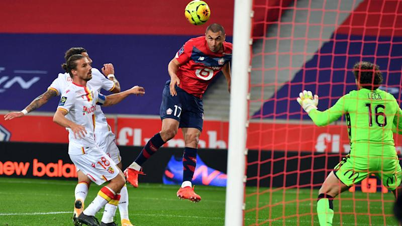 Lille go top of French league after routing 9-man Lens in northern derby