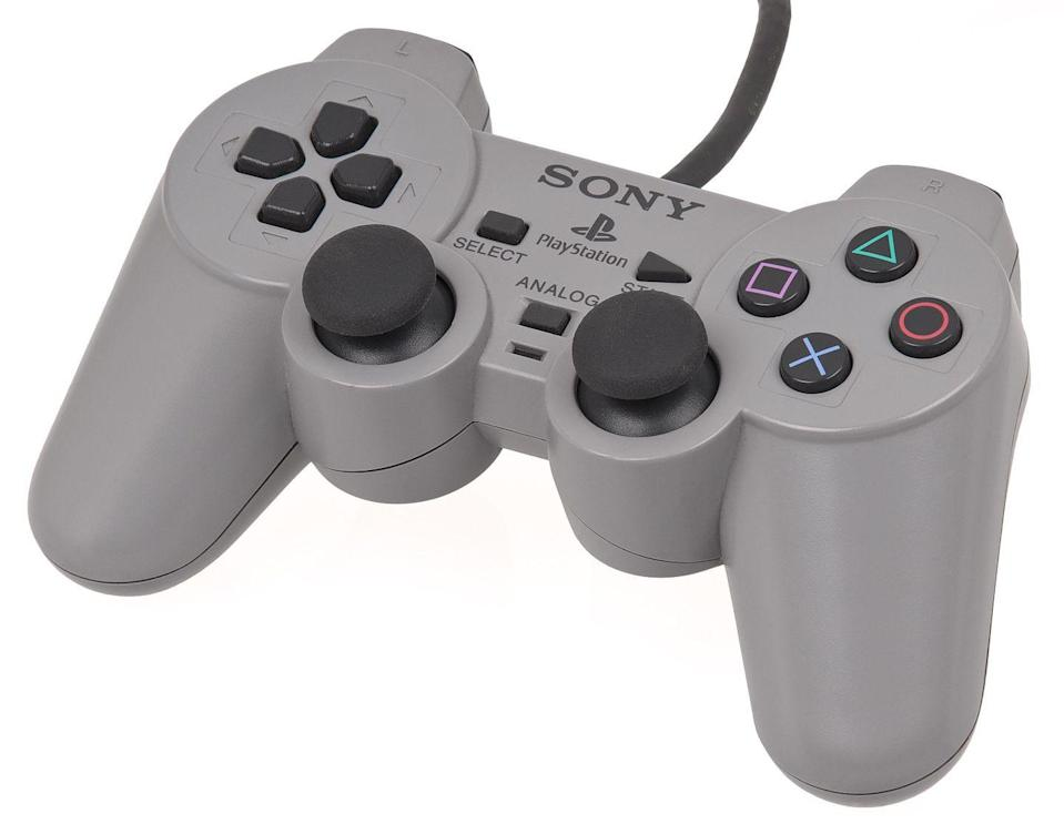 <p>The original PlayStation was still on the market in 1998, but Sony did something to revitalize the system and the way users played games. It introduced the DualShock PlayStation controller. It added two analog sticks at the bottom of the controller as well as a rumble functionality that would shake when players performed certain actions in-game. This was similar to the Nintendo 64's optional Rumble Pak accessory, instead built into the controller itself. </p><p>The introduction of the DualShock was an important turning point for PlayStation as a whole, as the controller design has remained largely the same over the years save for small improvements throughout iterations, with the DualShock 2 DualShock 3 releases adding Bluetooth support and other tweaks, but remaining mostly similar to this original revolutionary debut.</p>