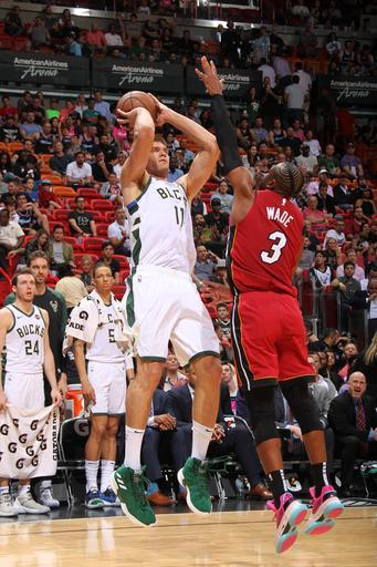 MIAMI, FL - MARCH 15: Brook Lopez #11 of the Milwaukee Bucks shoots the ball against the Miami Heat on March 15, 2019 at American Airlines Arena in Miami, Florida. (Photo by Oscar Baldizon/NBAE via Getty Images)