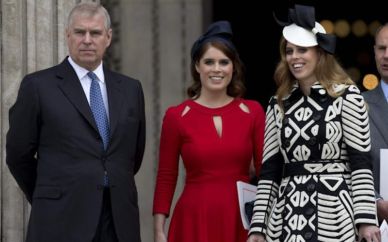Prince Andrew with his daughters, Princess Eugenie and Princess Beatrice -  JUSTIN TALLIS/AFP