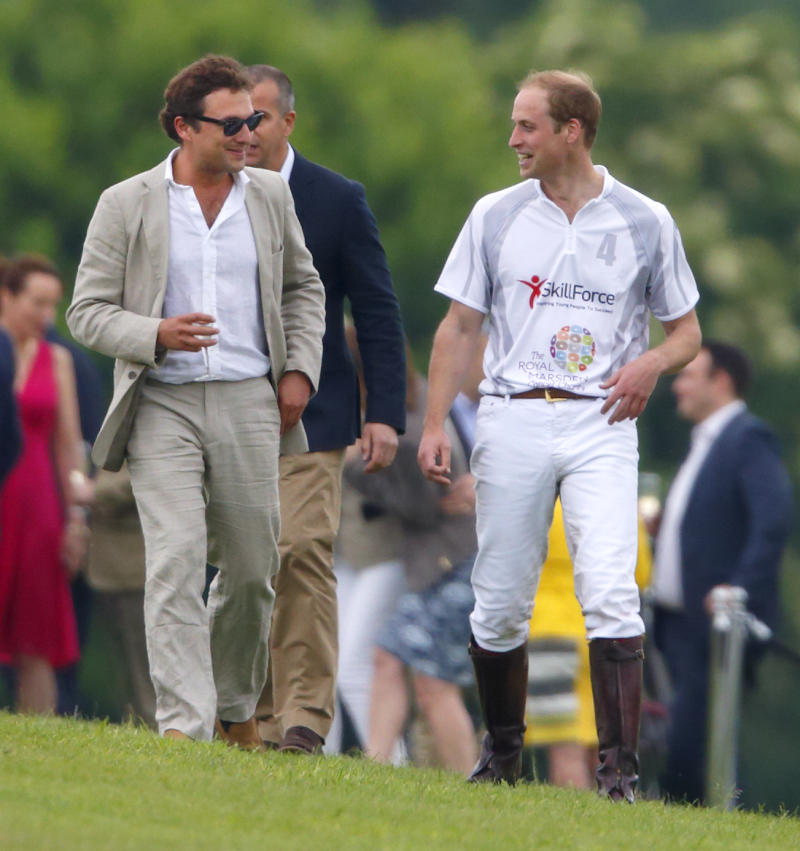 Prince William, Duke of Cambridge talks with Thomas van Straubenzee after playing in the Audi Polo Challenge at Coworth Park Polo Club on May 31, 2014 in Ascot, England.