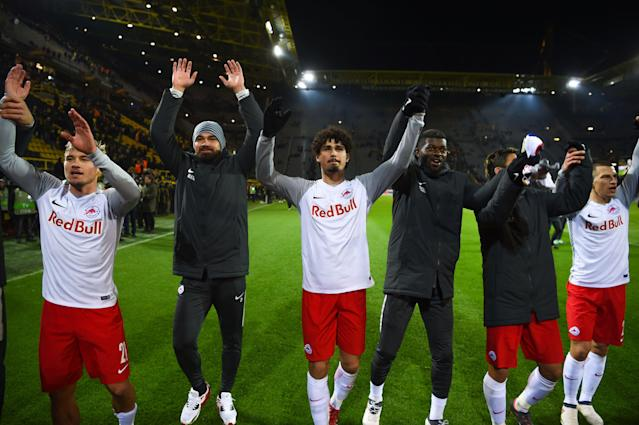 Salzburg players celebrate with their travelling supporters after the historic victory.