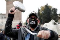 FILE PHOTO: Italian restaurant and bar workers protest against the government's COVID-19 rules, in Rome