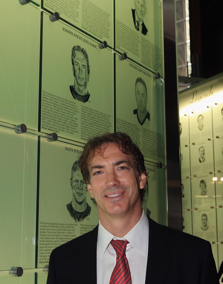 TORONTO, ON - NOVEMBER 12: Joe Sakic poses by his Hall of Fame plaque following a photo opportunity at the Hockey Hall of Fame on November 12, 2012 in Toronto, Canada. Sakic and three other former NHL players - Mats Sundin, Adam Oates and Pavel Bure - will be inducted into the Hall during a ceremony later today. (Photo by Bruce Bennett/Getty Images)