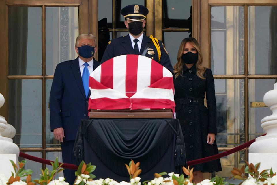 President Donald Trump and first lady Melania Trump pay respects as Justice Ruth Bader Ginsburg lies in repose at the Supreme Court building on Thursday, Sept. 24, 2020.