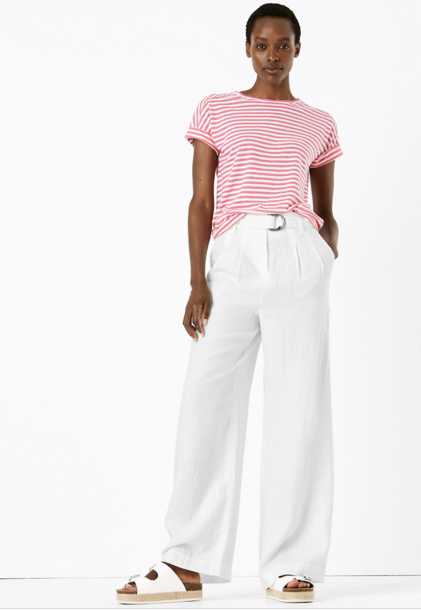 The linen trousers come in five summer-ready hues: navy, black, grey, white and beige. (Marks & Spencer)