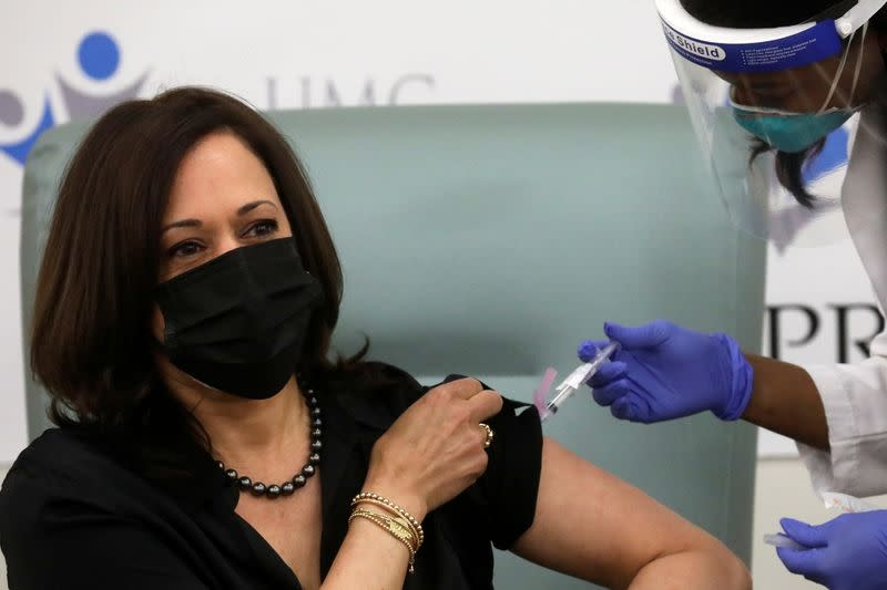 U.S. Vice President-elect Kamala Harris receives a dose of the Moderna COVID-19 vaccine in Washington