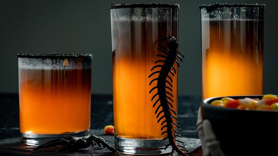 """<p>Halloween doesn't have to be <em>all</em> about candy when you can make this pumpkin-colored <a href=""""https://www.thedailymeal.com/drink/classic-cocktail-origins?referrer=yahoo&category=beauty_food&include_utm=1&utm_medium=referral&utm_source=yahoo&utm_campaign=feed"""" rel=""""nofollow noopener"""" target=""""_blank"""" data-ylk=""""slk:cocktail"""" class=""""link rapid-noclick-resp"""">cocktail</a>. All you need to do is mix pineapple juice with white rum, coconut extract, food coloring and sparkling white wine to create this odd-colored recipe.</p> <p><a href=""""https://www.thedailymeal.com/recipe/halloween-orange-cocktail-recipe?referrer=yahoo&category=beauty_food&include_utm=1&utm_medium=referral&utm_source=yahoo&utm_campaign=feed"""" rel=""""nofollow noopener"""" target=""""_blank"""" data-ylk=""""slk:For the Orange Hocus Pocus Fizz recipe, click here"""" class=""""link rapid-noclick-resp"""">For the Orange Hocus Pocus Fizz recipe, click here</a>.</p>"""