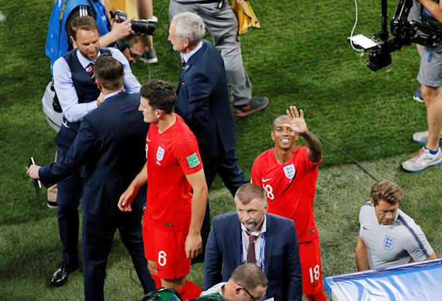 Soccer Football - World Cup - Group G - Tunisia vs England - Volgograd Arena, Volgograd, Russia - June 18, 2018 England manager Gareth Southgate, Harry Maguire and Ashley Young celebrate after the match REUTERS/Gleb Garanich