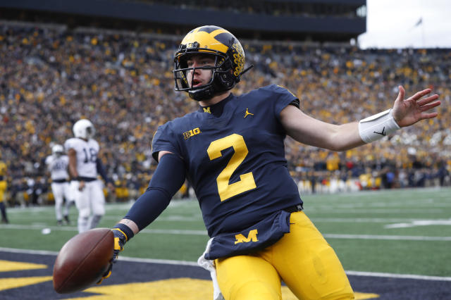 Michigan quarterback Shea Patterson celebrates his one-yard touchdown run in the first half of an NCAA college football game against the Penn State in Ann Arbor, Mich., Saturday, Nov. 3, 2018. (AP Photo/Paul Sancya)