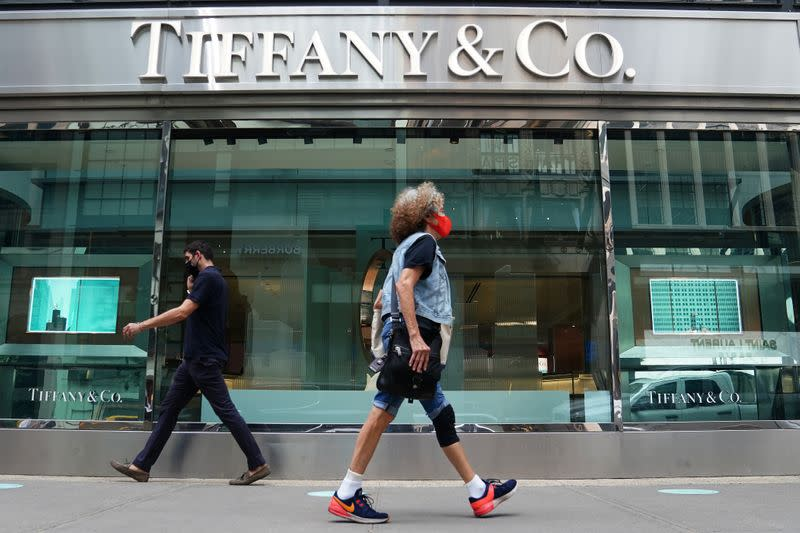 People walk past a Tiffany & Co. store in the Manhattan borough of New York City