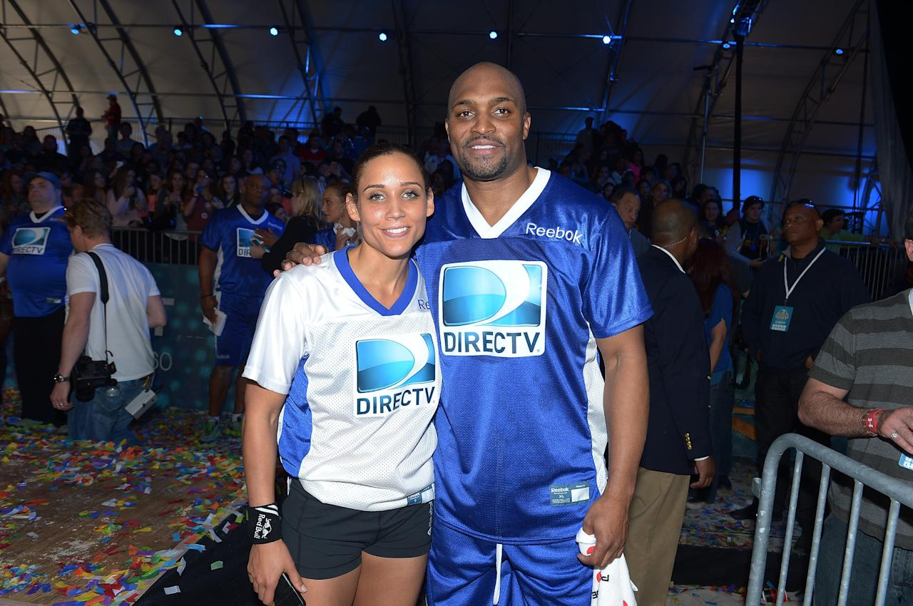 NEW ORLEANS, LA - FEBRUARY 02:  Lolo Jones and Amani Toomer attend DIRECTV'S Seventh Annual Celebrity Beach Bowl at DTV SuperFan Stadium at Mardi Gras World on February 2, 2013 in New Orleans, Louisiana.  (Photo by Michael Loccisano/Getty Images For DirecTV)