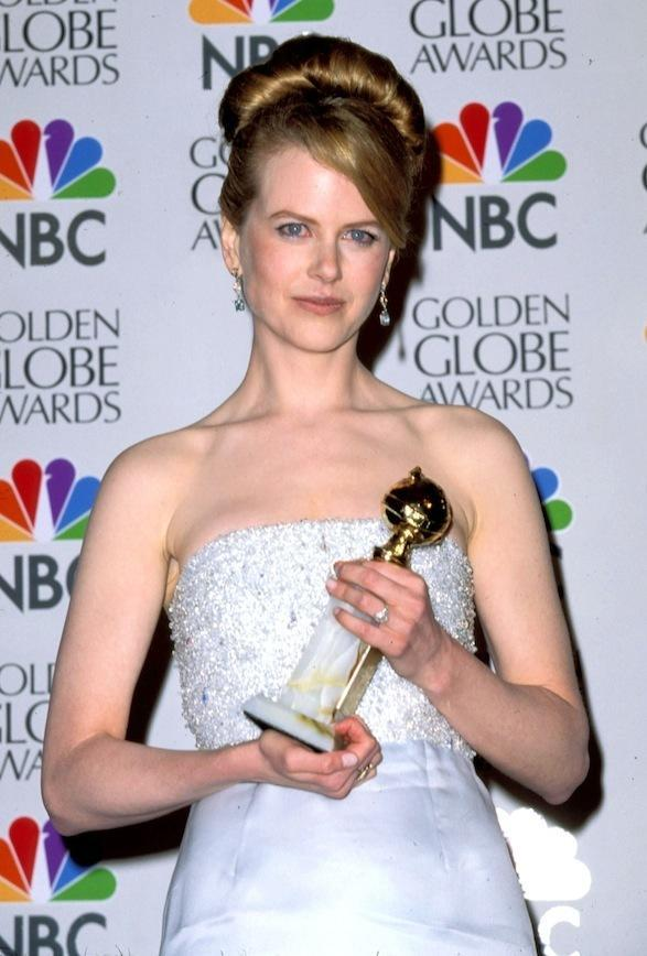 At the 1996 Golden Globe awards with her Golden Globe for Best Actress in a motion picture, for her role in To Die For.