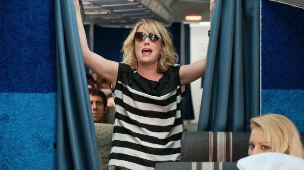 You don't need to sneak into first class like Annie (Kristen Wiig) in the film Bridesmaids. Image: Universal Pictures