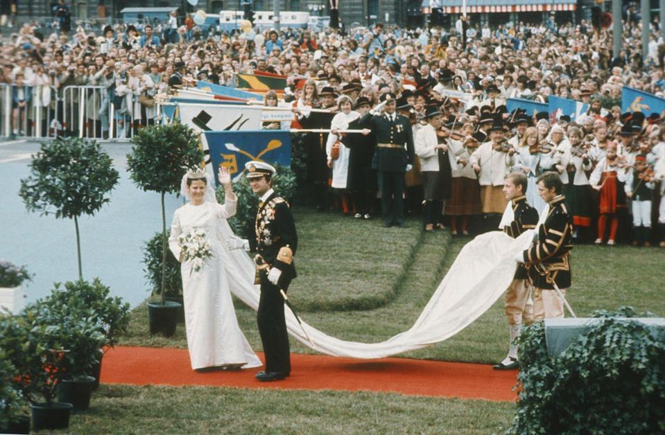 <p>Sweden's current queen wore a long-sleeve sheath that featured a stunning train when she married Carl XVI Gustaf.</p>