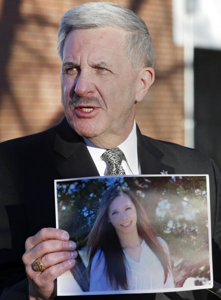Arapahoe County Sheriff Grayson Robinson holds a picture of Claire Davis the 17-year-old student that was shot during a briefing Saturday, Dec. 14, 2013, at Arapahoe High School in Centennial, Colo. Davis was shot by 18-year-old shooting suspect Karl Halverson Pierson at the school on Friday before he took his own life. (AP Photo/Ed Andrieski)