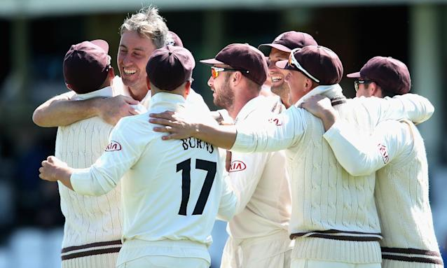 Surrey celebrate victory during day four of the County Championship Division One match with Yorkshire at the Oval.
