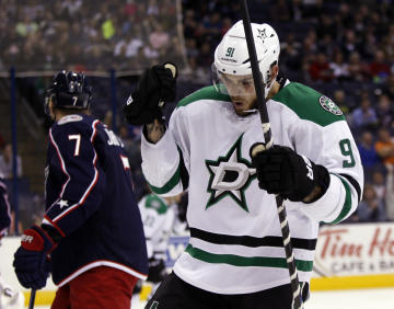 Dallas Stars' Tyler Seguin, right, celebrates his goal in the first period in front of Columbus Blue Jackets' Jack Johnson during an NHL hockey game in Columbus, Ohio, Tuesday, Oct. 14, 2014. Seguin had three goals in the game. Dallas won 4-2. (AP Photo/Paul Vernon)