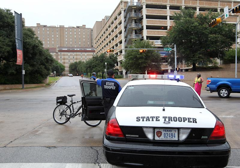State troopers secure the University of Texas campus after students evacuated because of a bomb threat Friday morning, Sept. 14, 2012 in Austin, Texas. The university received a call about 8:35 a.m. local time from a man claiming to be with al-Qaida who said he had placed bombs all over the 50,000-student Austin campus, according to University of Texas spokeswoman Rhonda Weldon. (AP Photo/Statesman.com, Ralph Barrera)