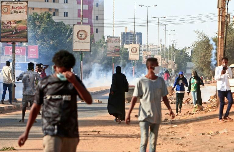 Protesters take to the streets of Khartoum, where officials hope the end of the US designation of Sudan as a state sponsor of terrorism will provide a needed economic boost