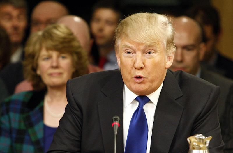 In this photo released by the Scottish Parliament dated Wednesday April 25, 2012, US business magnate Donald Trump gives evidence to the Scottish Parliament's Economy Energy and Tourism Committee in Edinburgh, Scotland. Members of the committee are looking at how achievable the Scottish Government's green energy targets for 2020 are, with the meeting focusing on the impact the renewables industry could have on tourism and local communities. (AP Photo/Andrew Cowan/Scottish Parliament)