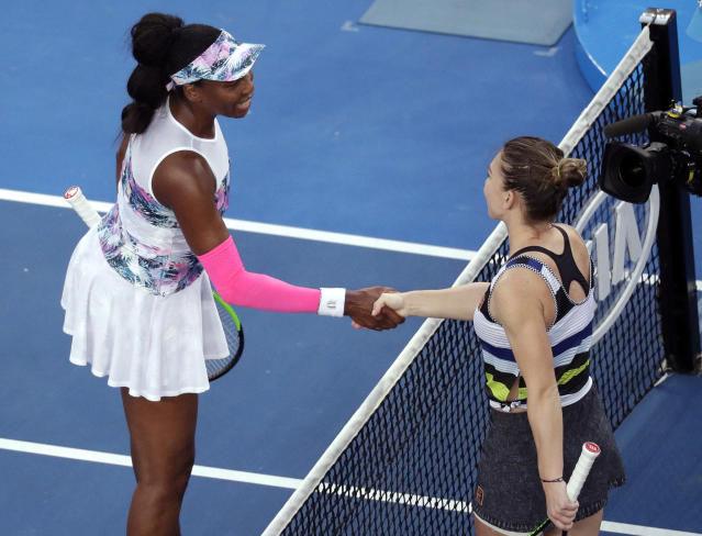 Romania's Simona Halep, right, is congratulated by United States' Venus Williams after winning their third round match at the Australian Open tennis championships in Melbourne, Australia, Saturday, Jan. 19, 2019. (AP Photo/Kin Cheung)