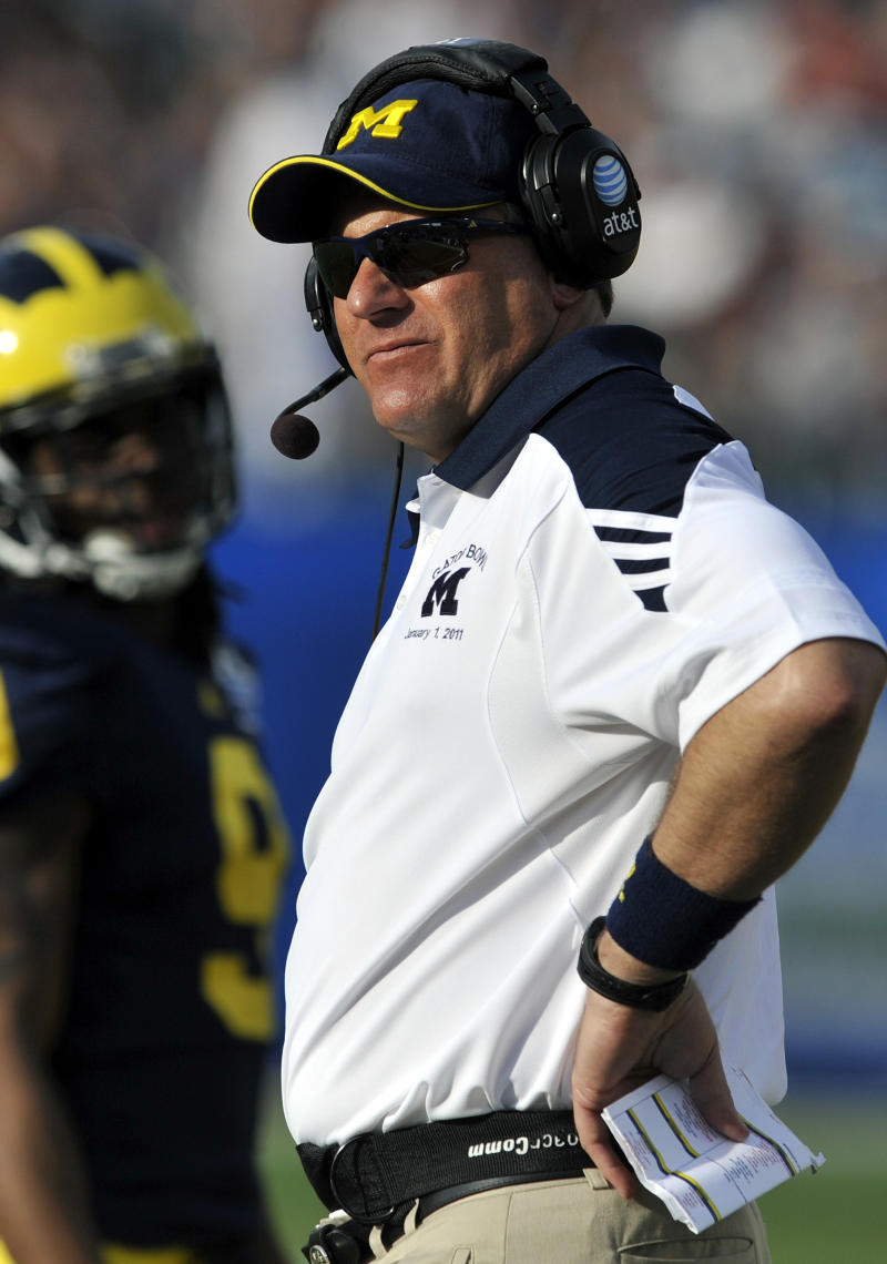 Michigan head coach Rich Rodriguez reacts to a call during the second half of the Gator Bowl NCAA college football game against Mississippi State in Jacksonville, Fla., Saturday, Jan. 1, 2011. Mississippi State beat Michigan 52-14. (AP Photo/Stephen Morton)