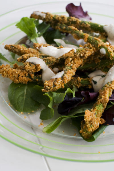 In this image taken on March 11, 2013, almond-crusted bake-fried asparagus is shown served on a plate in Concord, N.H. (AP Photo/Matthew Mead)