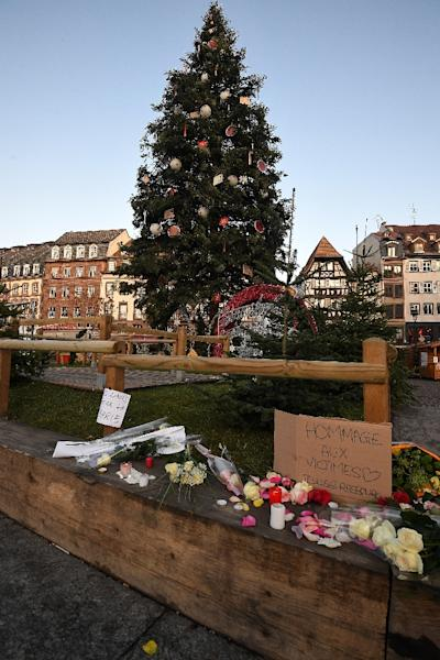 Flowers and candles were placed on Strasbourg's Place Kleber on Wednesday in tribute to the victims of the terror attack at the city's bustling Christmas market (AFP Photo/Patrick HERTZOG)