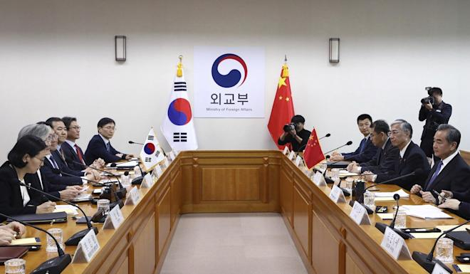 Kang Kyung-wha (second from left) stressed the importance of shared understanding to improve cooperation during the meeting with Wang Yi (right). Photo: AP